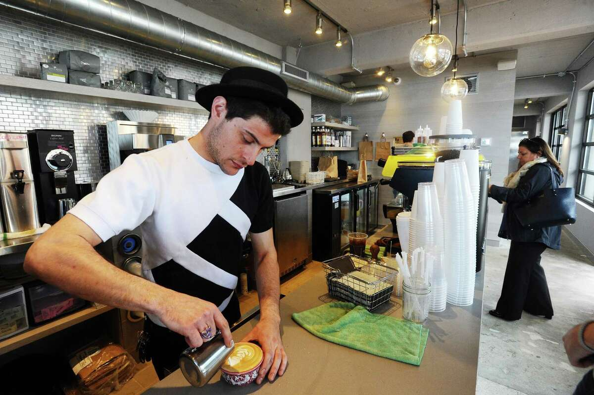 Stuart Schmerzler makes a latte inside the new Granola Bar at 700 Canal St. in Stamford, Conn. on Tuesday, May 9, 2017.