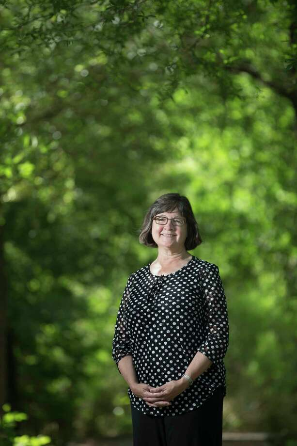 Beth White president and CEO of the Houston Parks Board, a non-profit organization leading Houston's $220 million Bayou Greenways 2020 project, poses for a portrait at a trail by the Houston Parks Board facilities on N Post Oak Lane, Wednesday, April 5, 2017, in Houston. ( Marie D. De Jesus / Houston Chronicle ) Photo: Marie D. De Jesus, Staff / © 2017 Houston Chronicle