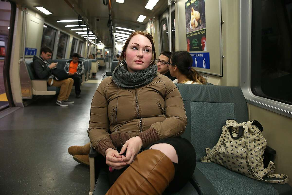 Kathryn Fried, 22 years old, from Livermore heads home on BART with her bag next to her on an uncrowded train on Tuesday, May 9, 2017, in San Francisco, Calif. Bart has an existing ordinance that makes it illegal for a single passenger to take up more than one seat.