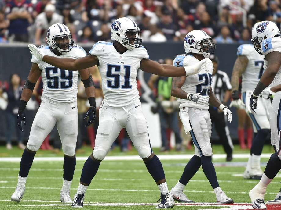 Tennessee Titans outside linebacker David Bass (51) and teammates celebrate a play against the Houston Texans during the second half of an NFL football game Sunday, Oct. 2, 2016, in Houston. (AP Photo/Eric Christian Smith) Photo: Eric Christian Smith/AP