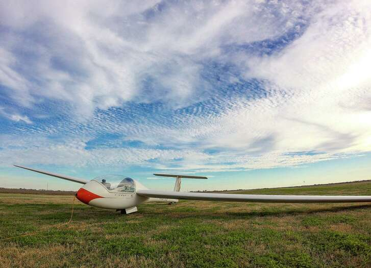 A Grob Astir glider waits on the ground at the Greater Houston Soaring Association.
