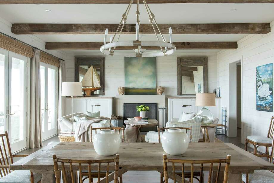 Audrey and Forrest Wylie head to their Galveston home for a respite from the hectic life of Houston. Audrey says she exhales deeply every time she drives over the causeway. Their living room is designed in classic beach colors and a relaxed style. Photo: Michael Hunter