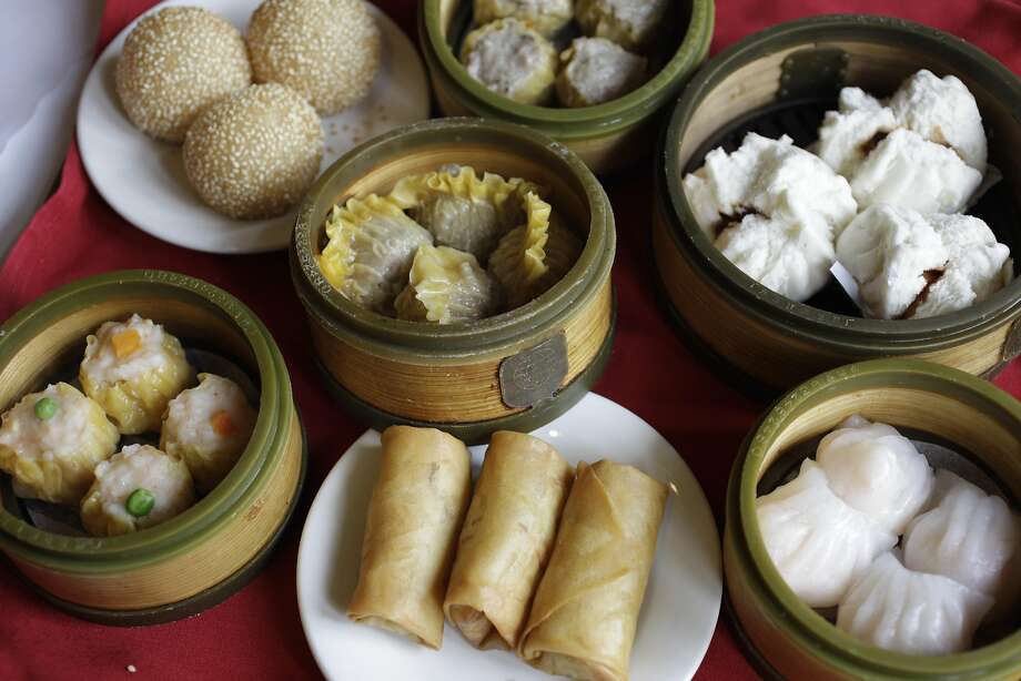 Popular banquet dim sum (including egg rolls, dumplings, sesame balls and har gow) at the now-closed Four Seas restaurant in Chinatown. Photo: Eric Risberg, ST