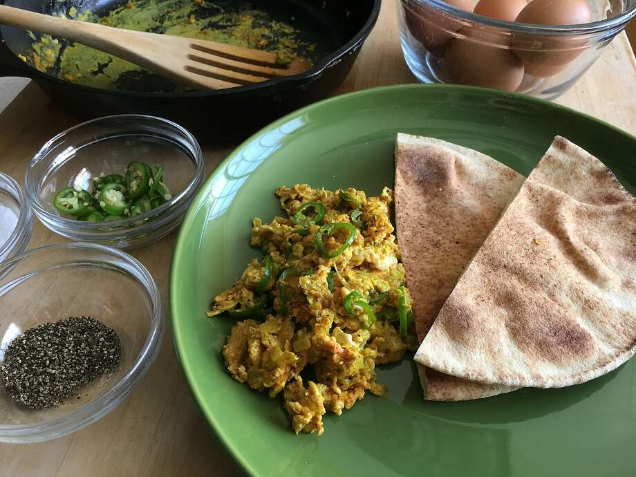 Omar's Mom's Churr Anda, eggs scrambled with onion, serrano chiles and turmeric, served with toasted pita bread. Photo: Sarah Fritsche