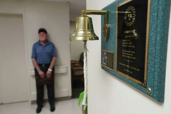 Osgood Bateman who has been receiving radiation treatment at MD Anderson, waits to have his last treatment Friday, April 21, 2017, in Houston and rang the bell. He has undergone radiation treatments for a rare and particularly deadly form of face cancer. The ceremonial bell is a nationwide cancer care tradition that began 20 years ago at MD Anderson.