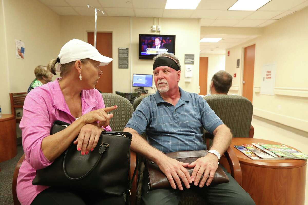 Osgood Bateman who has been receiving radiation treatment at MD Anderson, talks to Stephanie O'Keefe before he had his last treatment April 21, 2017. He has undergone radiation treatments for a rare and particularly deadly form of face cancer.