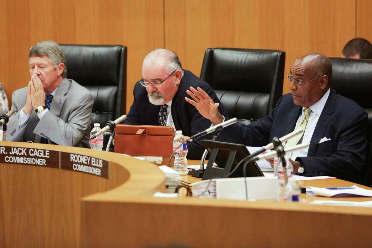 Harris County Commissioner Rodney Ellis, right, asks a question as the Commissioner' Court listen to testimony before voting 4-1 to appeal a federal civil rights lawsuit regarding the county's bail system Tuesday, May 9, 2017 in Houston. Chief U.S. District Judge Lee H. Rosenthal declared the county's system unconstitutional for holding people accused of low-level offenses in jail because they can't afford to pay bail.