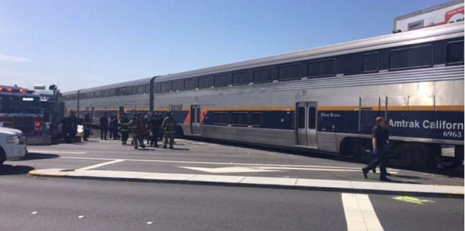 An Amtrak train hit a truck in Richmond Tuesday morning, officials said.
