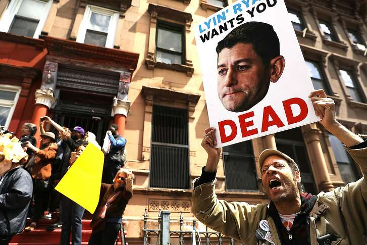 NEW YORK, NY - MAY 09:  Dozens of health care activists protest in front of a Harlem charter school before the expected visit of House Speaker Paul Ryan on May 9, 2017 in New York City. The activists groups are highly critical of Ryan and the recent passage of the GOP healthcare bill in the House.  (Photo by Spencer Platt/Getty Images) *** BESTPIX ***