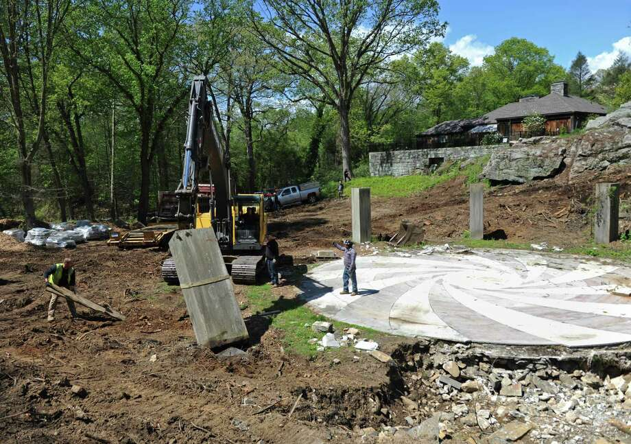 A construction crew disassembled the marble backyard amphitheater in Cos Cob Tuesday. The amphitheater, built in the 1930s, is in the process of being disassembled and rebuilt at Sarah Lawrence College in Bronxville, N.Y. Photo: Tyler Sizemore / Hearst Connecticut Media / Greenwich Time