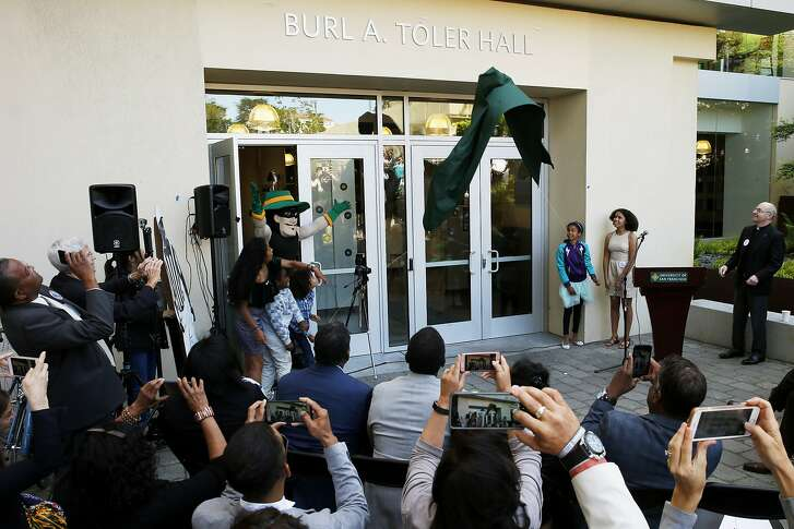 The grandchildren of the late Burl Toler unveil the building name at the University of San Francisco on Tuesday, May 9, 2017, in San Francisco, Calif. USF renamed the building from Phelan Hall to Burl A. Toler Hall.