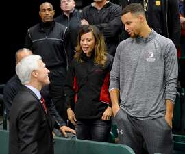 Davidson head coach Bob McKillop joins NBA MVP Stephen Curry and his mom Sonya Curry following the Wildcat win over Charlotte in the Battle of the Hornets' Nest annual non-conference basketball game at Halton Arena on Tuesday, December 01, 2015 in Charlotte, North Carolina. Former Wildcat Curry is in town to take on the Charlotte Hornets tomorrow as Davidson won 109-74.