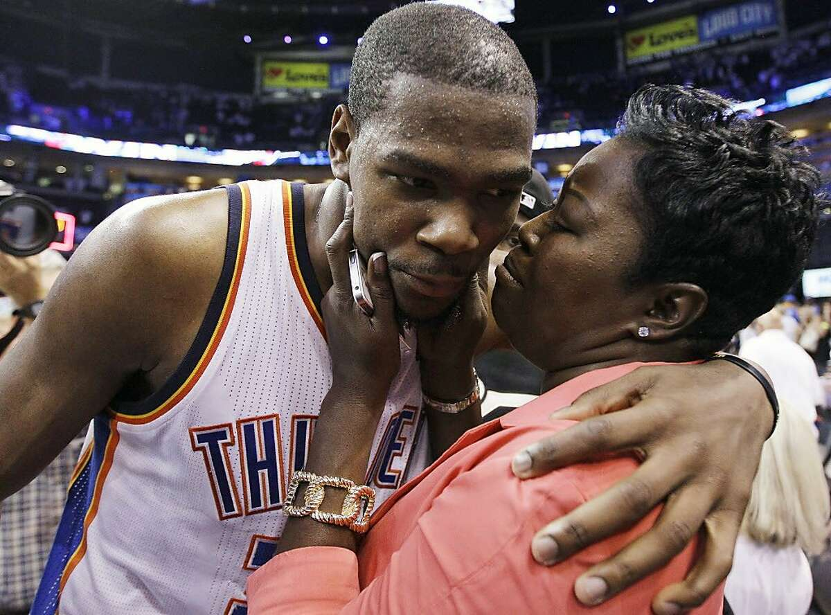 Oklahoma City Thunder's Kevin Durant (35) is embraced and kissed by his mother, Wanda Pratt, after the Thunder's 109-103 win over the San Antonio Spurs in Game 4 of the NBA basketball playoffs Western Conference finals, Saturday, June 2, 2012, in Oklahoma City. (AP Photo/Eric Gay)