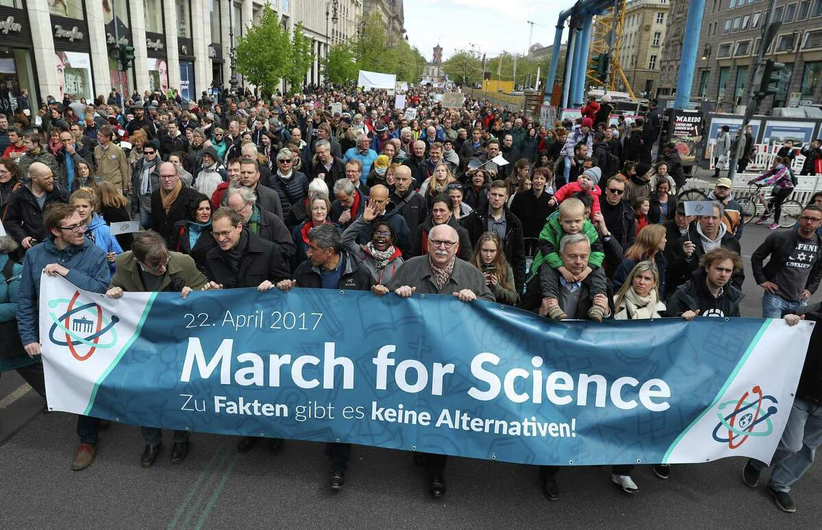 People march in support of scientific research during the