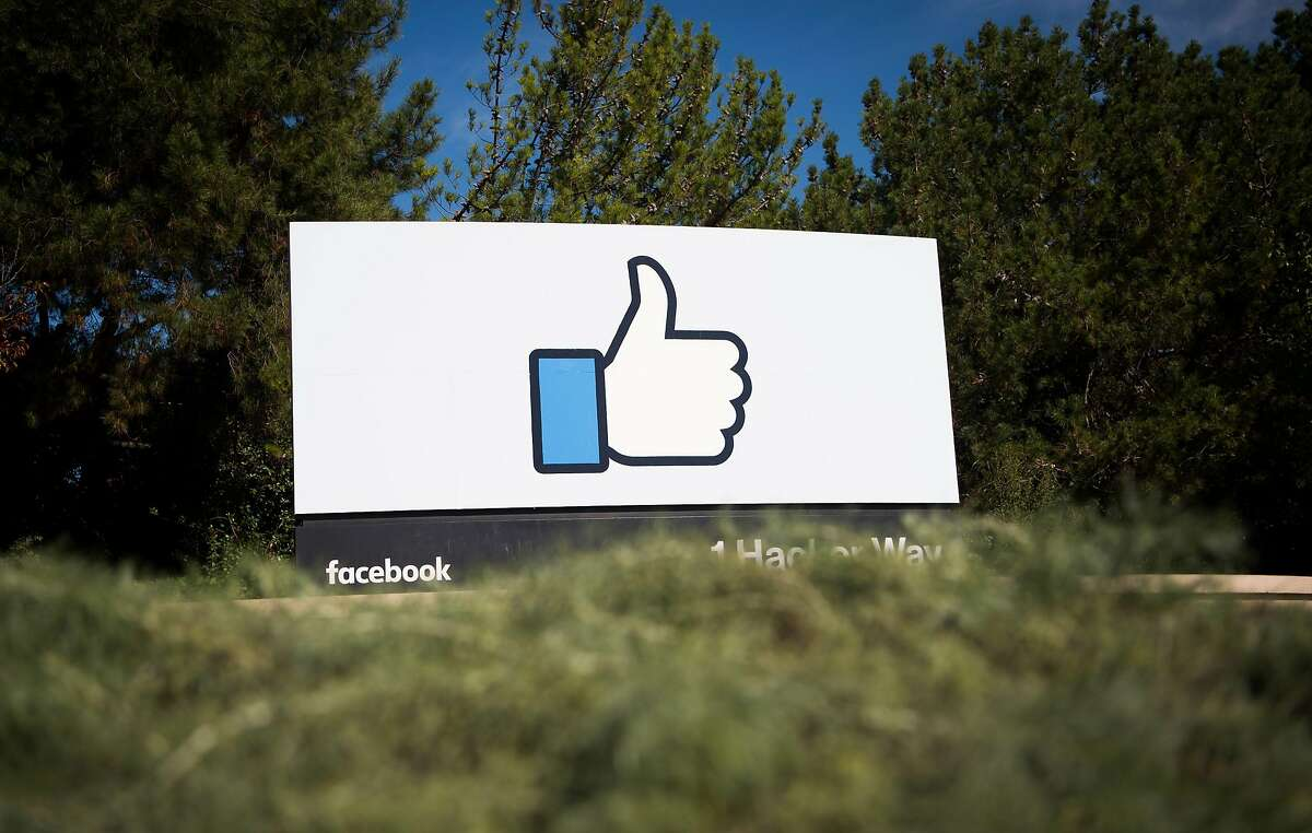 (FILES) This file photo taken on November 4, 2016 shows the Facebook sign and logo in Menlo Park, California. Facebook said on May 3, 2017, it would add 3,000 people to screen out violent content as the social media giant faces scrutiny for a series of killings and suicides broadcast on its platform.