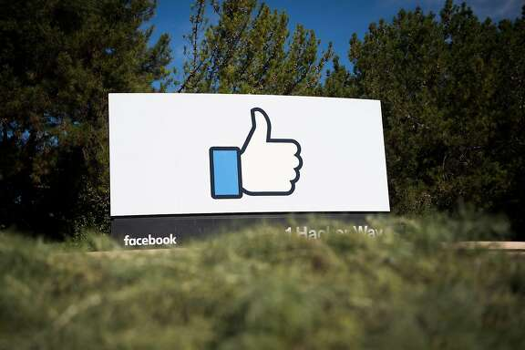 """(FILES) This file photo taken on November 4, 2016 shows the Facebook sign and logo in Menlo Park, California.  Facebook said on May 3, 2017, it would add 3,000 people to screen out violent content as the social media giant faces scrutiny for a series of killings and suicides broadcast on its platform. """"If we're going to build a safe community, we need to respond quickly,"""" chief executive Mark Zuckerberg said on his Facebook page.  / AFP PHOTO / JOSH EDELSONJOSH EDELSON/AFP/Getty Images"""
