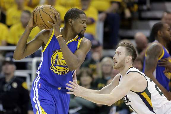 Utah Jazz forward Gordon Hayward (20) guards Golden State Warriors forward Kevin Durant (35) in the second half during Game 4 of the NBA basketball second-round playoff series Monday, May 8, 2017, in Salt Lake City. The Warriors completed a second-round sweep of the Utah Jazz with a 121-95 victory. (AP Photo/Rick Bowmer)