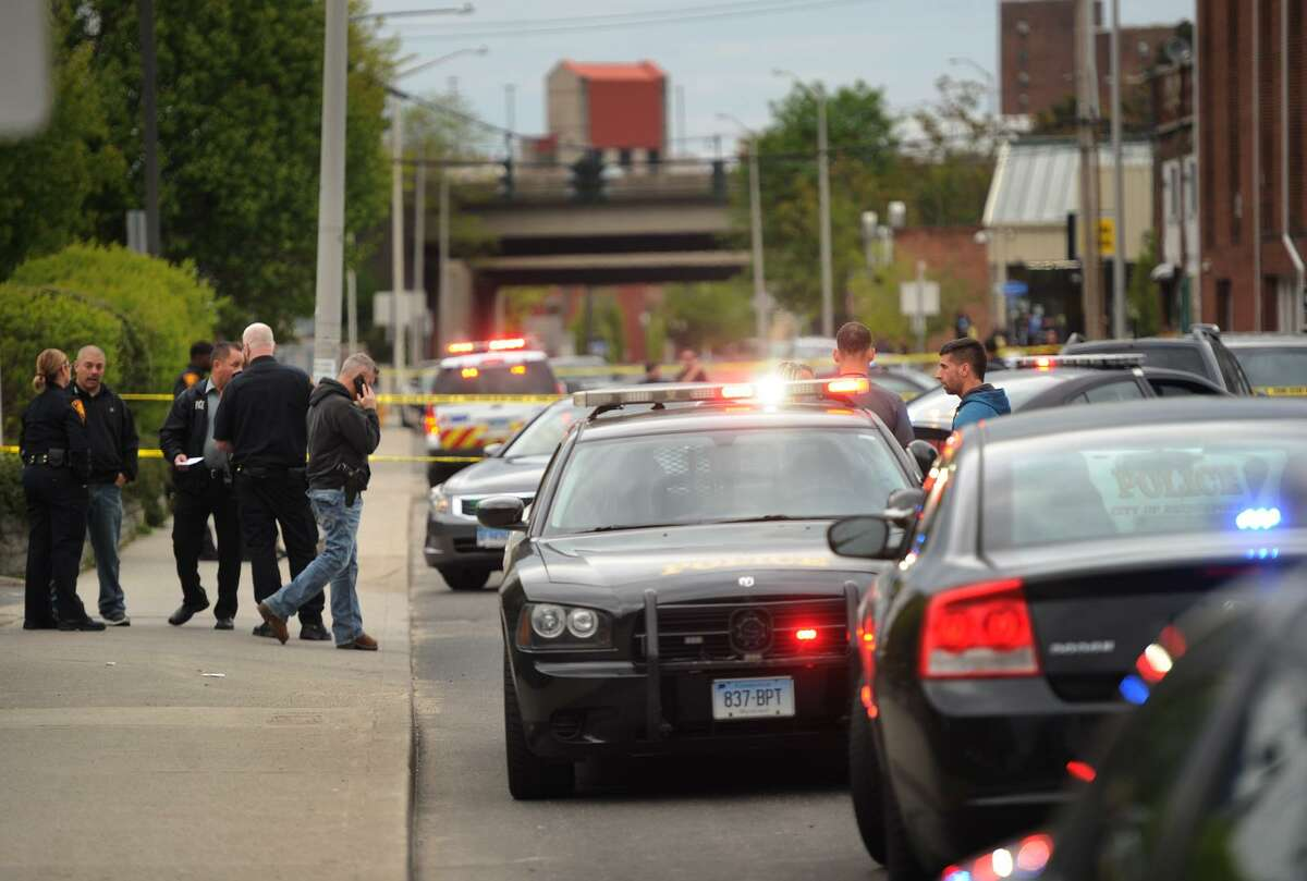 Bridgeport police on the scene of a fatal shooting on John Street near the intersection with Park Avenue on Tuesday.