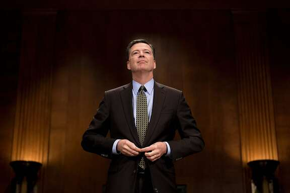 "(FILES) This file photo taken on May 3, 2017 shows FBI Director James Comey as he prepares to testify before the Senate Judiciary Committee on Capitol Hill in Washington, DC. US President Donald Trump on May 9, 2017 made the shock decision to fire his FBI director James Comey, the man who leads the agency charged with investigating his campaign's ties with Russia.""The president has accepted the recommendation of the Attorney General and the deputy Attorney General regarding the dismissal of the director of the Federal Bureau of Investigation,"" White House spokesman Sean Spicer told reporters.  / AFP PHOTO / JIM WATSONJIM WATSON/AFP/Getty Images"