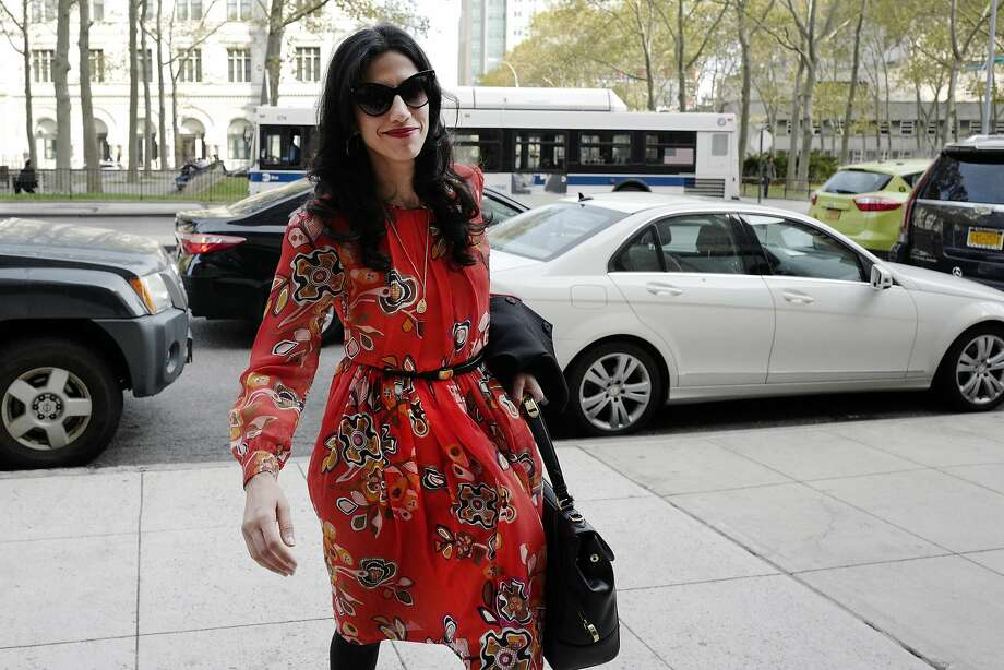"FILE - In this Nov. 2, 2016 file photo, Huma Abedin is seen in the Brooklyn borough of New York. A person familiar with the investigation into Hillary Clinton's use of a private email server says Abedin did not forward ""hundreds and thousands"" of emails to her husband's laptop, as FBI Director James Comey testified to Congress. (AP Photo/Mark Lennihan, File) Photo: Mark Lennihan, Associated Press"