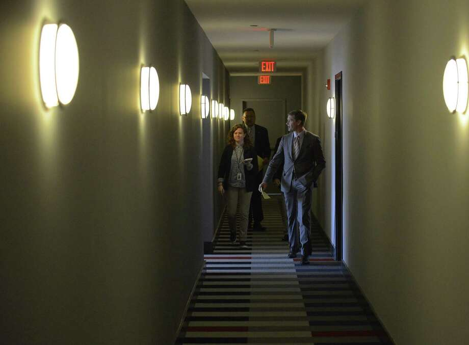 Members of the Stamford Chamber of Commerce and the media walk a hallway during a tour of the new UConn Stamford dorms on May 4, 2017. Photo: Matthew Brown / Hearst Connecticut Media / Stamford Advocate