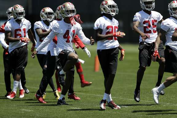 San Francisco 49ers rookies including cornerback Ahkello Witherspoon (410 go through drills during NFL football rookie minicamp Friday, May 5, 2017, in Santa Clara, Calif. (AP Photo/Marcio Jose Sanchez)