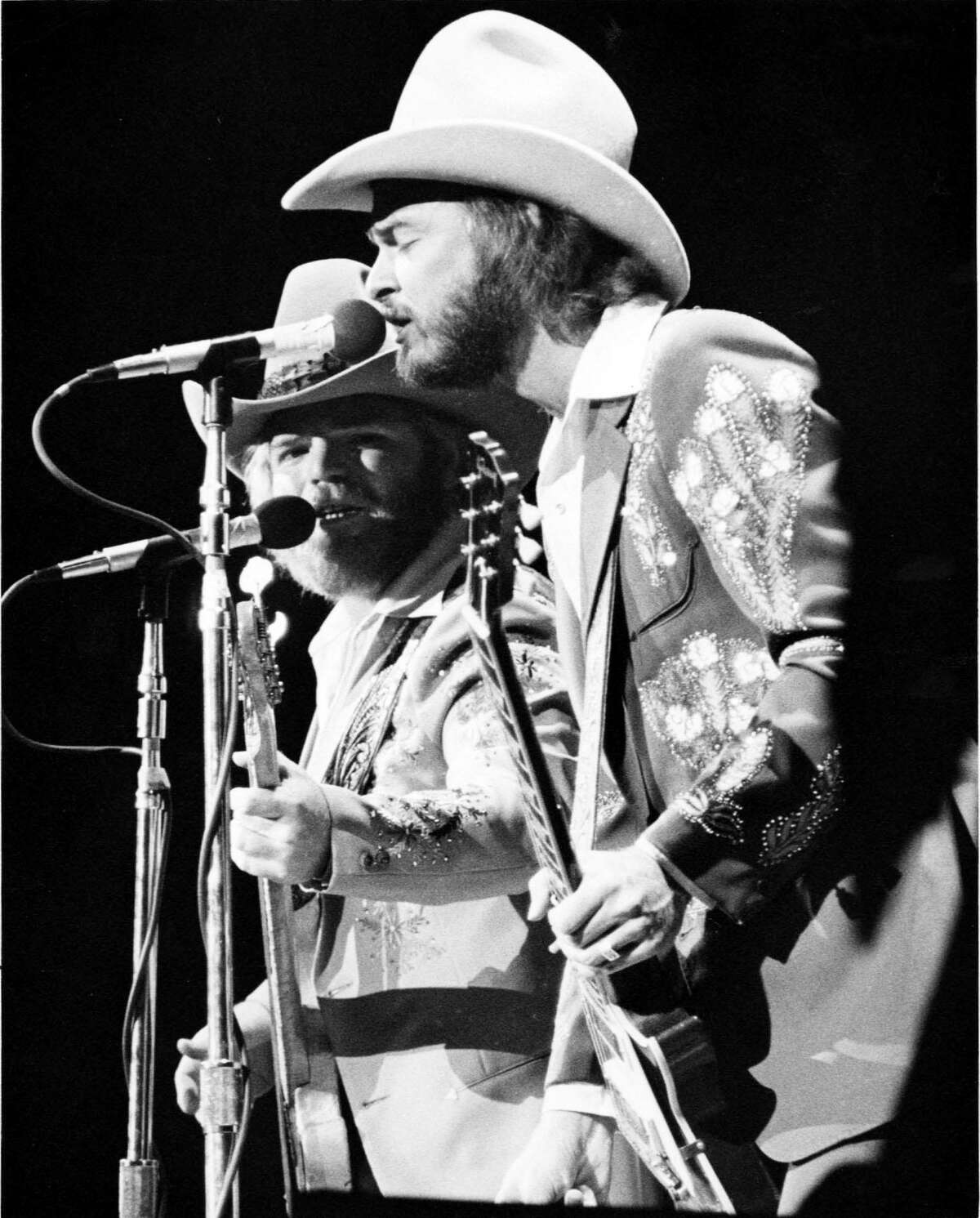 Dusty Hill, left, and Billy Gibbons of ZZ Top perform their first concert at the Summit in Houston in 1975.