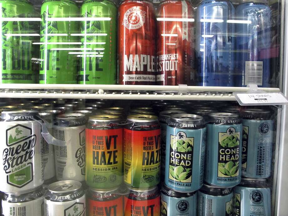 Different varieties of Vermont craft beer sit in a store cooler at Mehuron's Market on Tuesday, May 9, 2017, in Waitsfield, Vt. Vermont brewers have a message for the rest of the industry: don't go describing a brew as a Vermont beer if it's not from the Green Mountains. (AP Photo/Lisa Rathke) Photo: Lisa Rathke, Associated Press