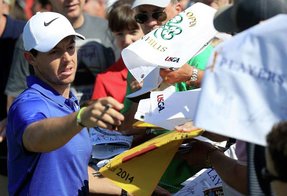 Rory McIlroy of Ireland signs autographs during a practice round prior to the THE PLAYERS Championship at the Stadium course at TPC Sawgrass on May 9, 2017 in Ponte Vedra Beach, Florida. Photo: Sam Greenwood, Staff / 2017 Getty Images