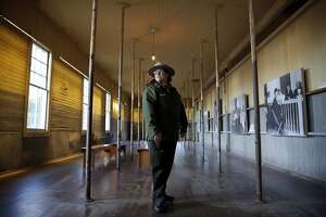 AISP Superintendent Amy Brees stands in a room of the former immigration center on Angel Island State Park, California, on Monday, Dec. 28, 2015.