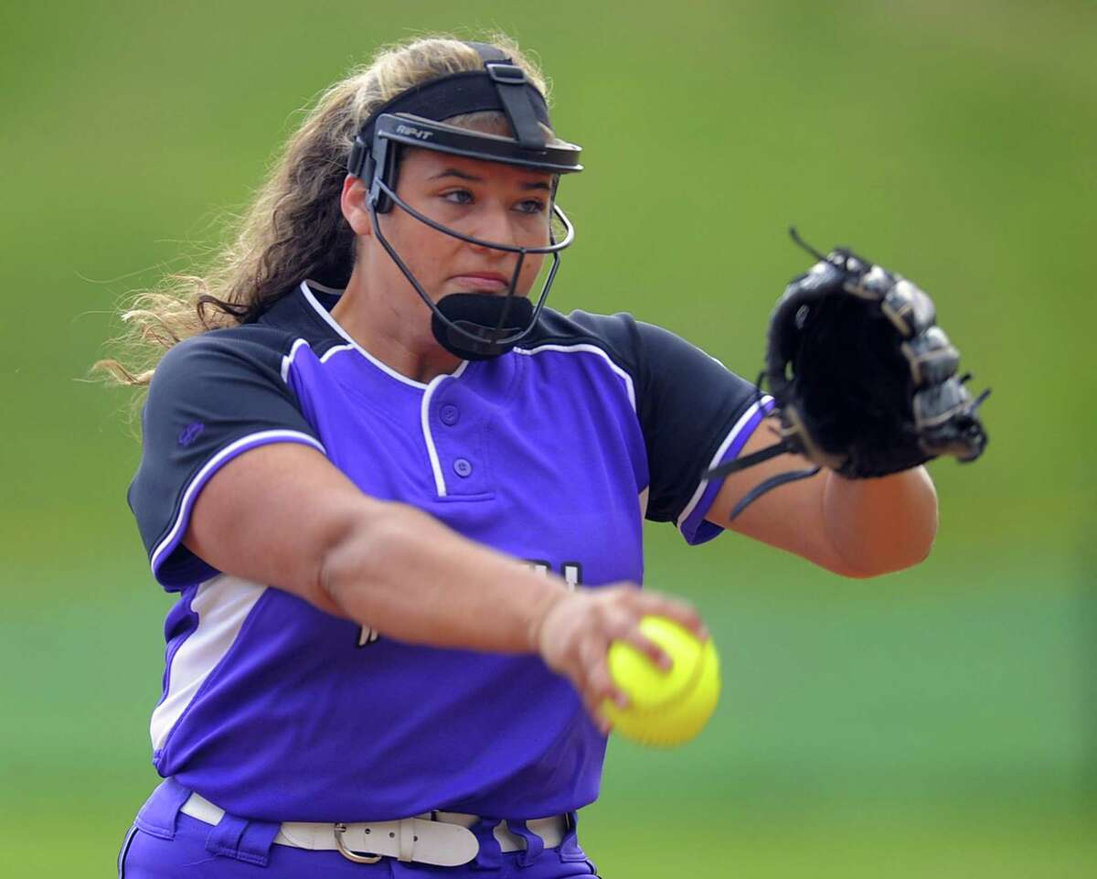 Westhill Edyliese Aquino delivers a pitch in the second inning of a varsity girls softball game against Fairfield Ludlowe at Westhill High School on May 9, 2017. Aquino's tossed a complete game five-hitter with seven strikeouts, helping the Vikings in their 4-0 win over the Falcons.