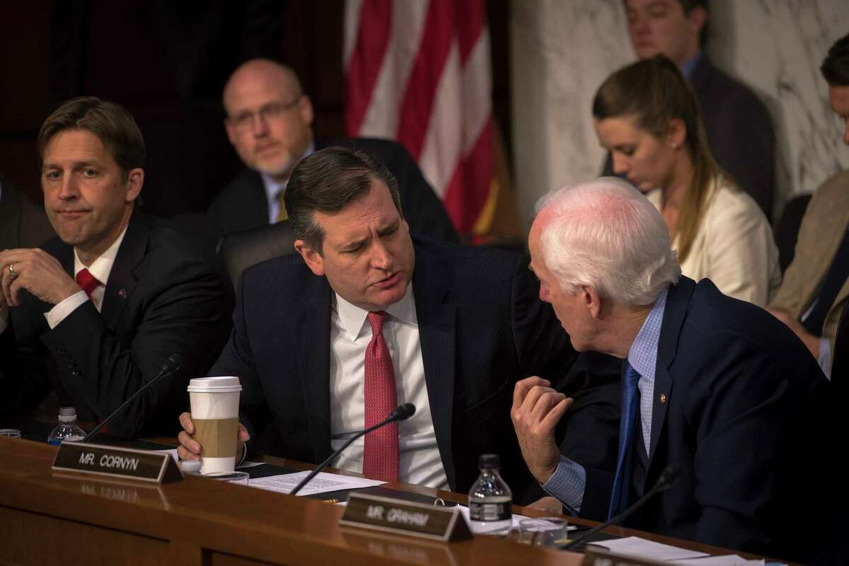 Texas Sens. Ted Cruz, left, and John Cornyn confer during a Senate Judiciary subcommittee hearing on Russia's alleged interference in last year's election, on Capitol Hill in Washington, May 8, 2017. Sally Yates, the former acting attorney general, and James Clapper, the former director of national intelligence, appeared before the committee. (Stephen Crowley/The New York Times)