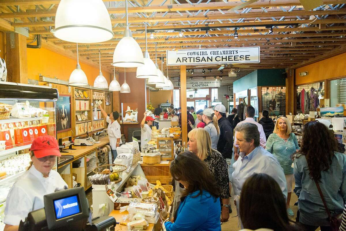 Crowds line the cheese cases at Cowgirl Creamery in Point Reyes Station, Calif., Saturday, May 23, 2015.