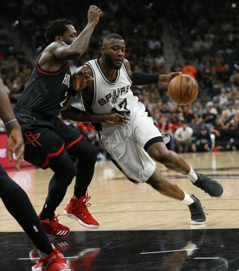 Spurs' Jonathon Simmons (17) drives on Houston Rockets' Patrick Beverley (02) in Game 5 of the Western Conference semifinals at the AT&T Center on Tuesday, May 9, 2017. (Kin Man Hui/San Antonio Express-News) Photo: Kin Man Hui/San Antonio Express-News