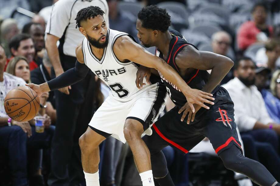 San Antonio Spurs guard Patty Mills (8) looks to dribble around Houston Rockets guard Patrick Beverley (2) during the first half of Game 5 of the second round of the Western Conference NBA playoffs at AT&T Center, Tuesday, May 9, 2017, in San Antonio. ( Karen Warren / Houston Chronicle ) Photo: Karen Warren/Houston Chronicle