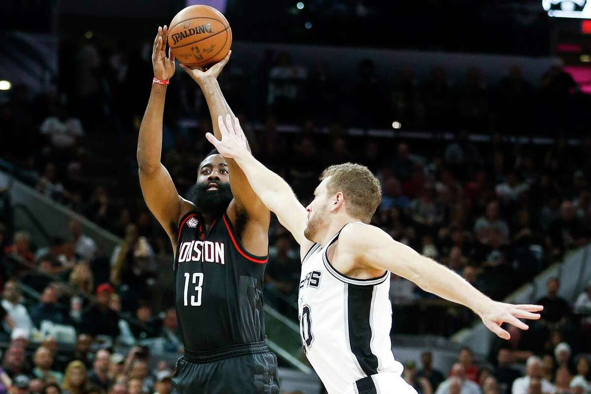Houston Rockets guard James Harden (13) takes a shot over San Antonio Spurs forward David Lee (10) during the first half of Game 5 of the second round of the Western Conference NBA playoffs at AT&T Center, Tuesday, May 9, 2017, in San Antonio.