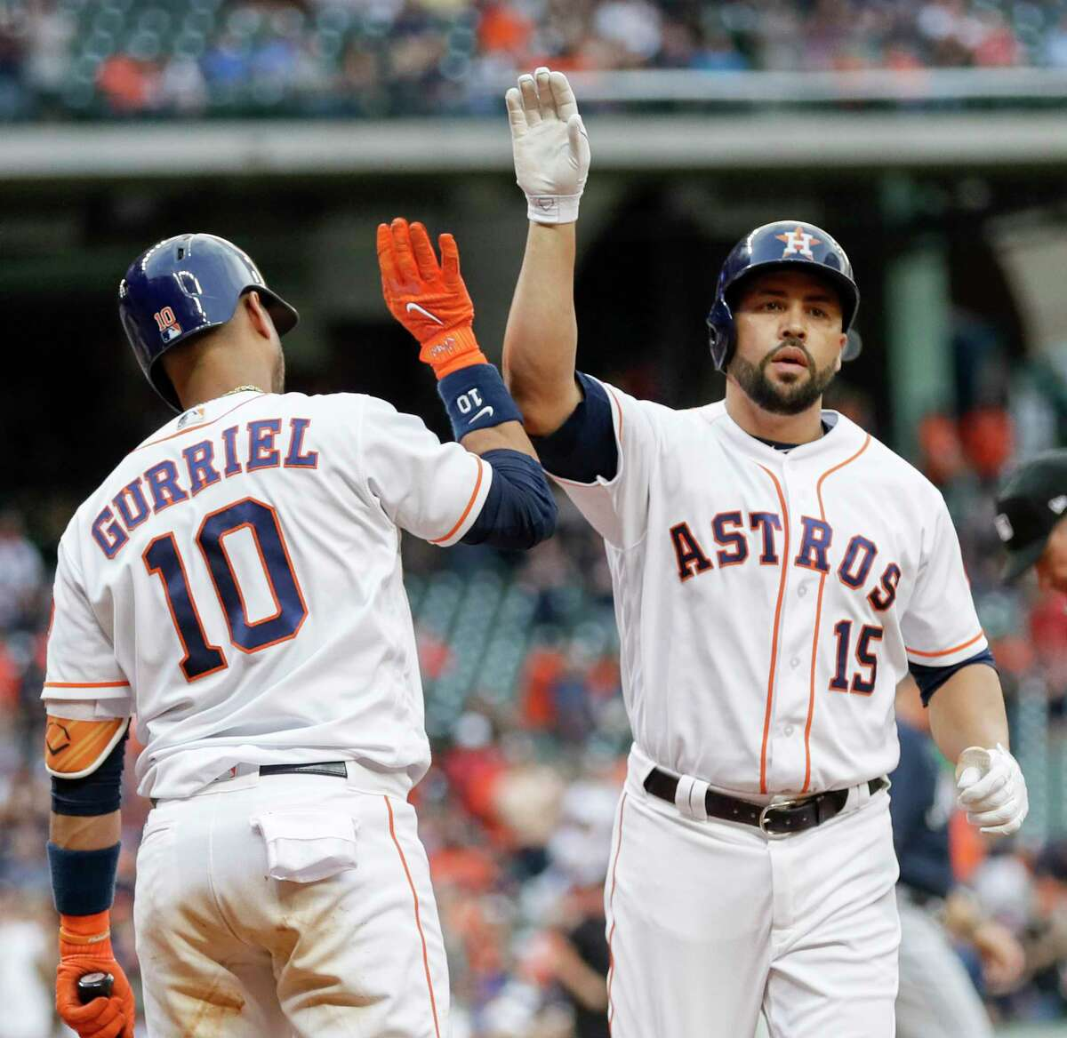 Houston Astros' Carlos Beltran (15) is congratulated by Yuli Gurriel (10) after hitting a home run against the Atlanta Braves during the first inning of a baseball game, Tuesday, May 9, 2017, in Houston. (AP Photo/David J. Phillip)