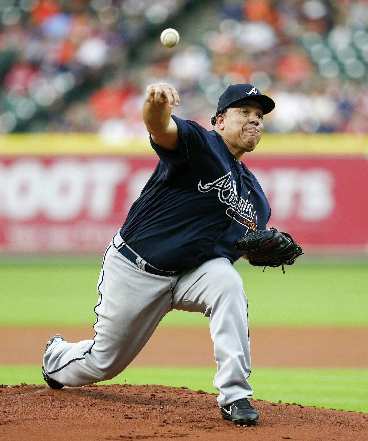 HOUSTON, TX - MAY 09: Starting pitcher Bartolo Colon #40 of the Atlanta Braves pitches in the first inning against the Houston Astros at Minute Maid Park on May 9, 2017 in Houston, Texas.