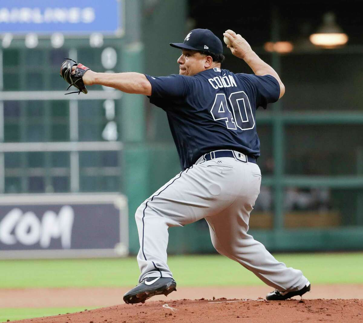Atlanta Braves starting pitcher Bartolo Colon throws against the Houston Astros during the first inning of a baseball game, Tuesday, May 9, 2017, in Houston. (AP Photo/David J. Phillip)