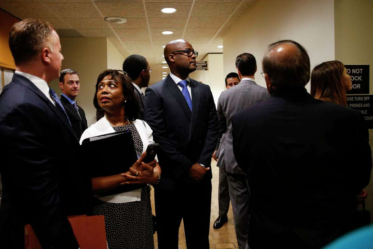 Judge Darrell Jordan, center, prepares to testify on Tuesday about his concerns with the current bail system in the county at Harris County Commissioners Court before the court voted 4-1 to appeal a federal civil rights lawsuit regarding the bail system.