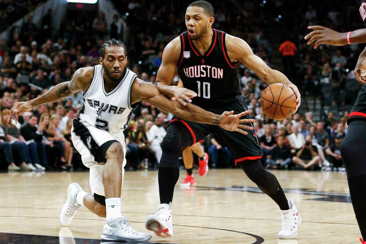 San Antonio Spurs forward Kawhi Leonard (2) reaches in to try to steal the ball from Houston Rockets guard Eric Gordon (10) during the first half of Game 5 of the second round of the Western Conference NBA playoffs at AT&T Center, Tuesday, May 9, 2017, in San Antonio.