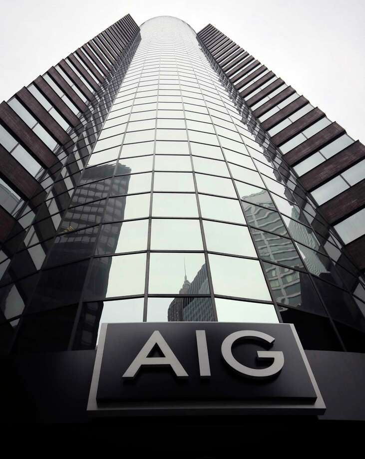FILE - This Wednesday, Jan. 9, 2013, file photo shows the American International Group logo at the company's headquarters in New York. A federal appeals court has upheld as lawful the government's bailout of AIG in the heat of the financial crisis. It overturned a lower-court decision favoring the insurance giant's former CEO. The ruling Tuesday, May 9, 2017, by the U.S. Court of Appeals for the Federal Circuit said a company controlled by ex-AIG chief Maurice Greenberg didn't have a legal right to pursue its claim against the government over the $85 billion bailout of the teetering AIG in September 2008. (AP Photo/Bebeto Matthews, File) Photo: Bebeto Matthews, STF / AP2013