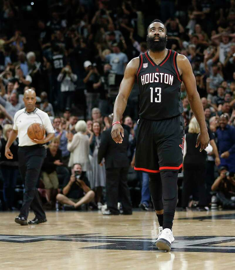 Guard James Harden had a triple-double after going 11-for-24 from the field, but his attempt in the waning seconds to tie the game was blocked by Manu Ginobili. Photo: Karen Warren, Staff Photographer / 2017 Houston Chronicle