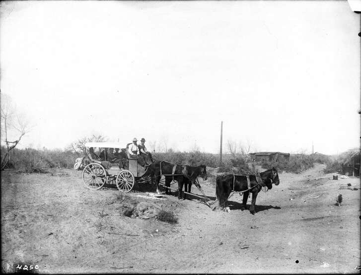 A full stagecoach travels along a dirt road in Yuma, Arizona, circa 1905, well after the San Antonio — San Diego mail route ended. The route was previously used for mail instead of passengers. And in this photo, horses pull the coach rather than the mules normally used on the mail line.