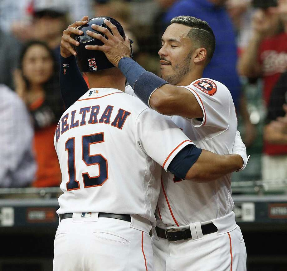 After homering moments earlier, Carlos Correa congratulates Carlos Beltran for doing the same. Photo: Bob Levey, Stringer / 2017 Getty Images