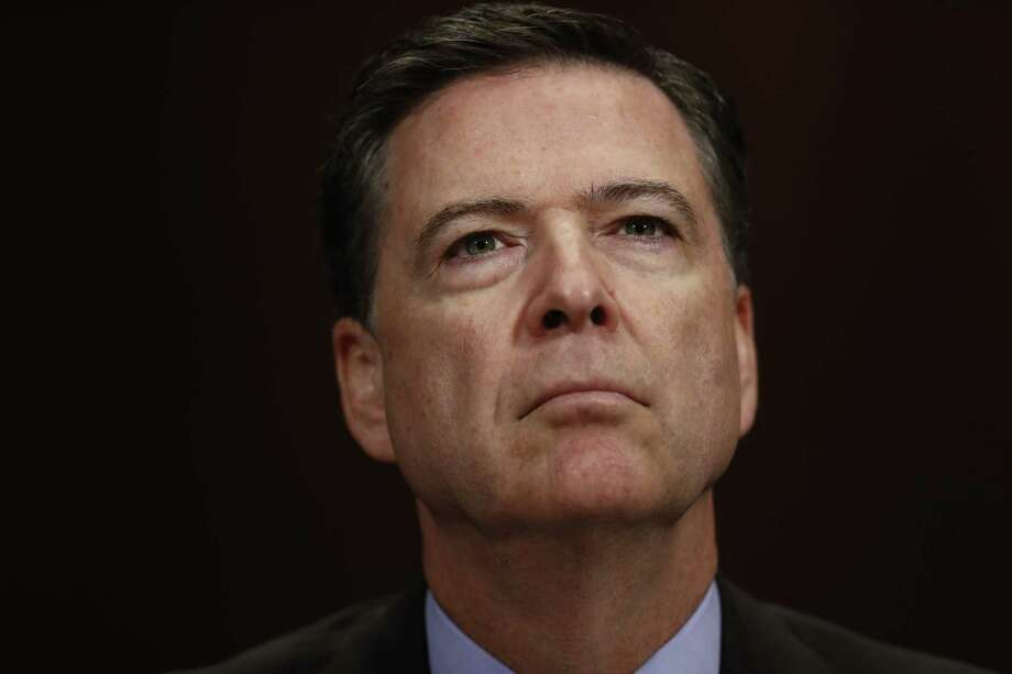 "FILE- In this May 3, 2017, file photo, FBI Director James Comey listens on Capitol Hill in Washington. President Donald Trump has fired Comey. In a statement on Tuesday, May 9, Trump says Comey's firing ""will mark a new beginning"" for the FBI. (AP Photo/Carolyn Kaster, File) ORG XMIT: NYJK305 Photo: Carolyn Kaster / Copyright 2017 The Associated Press. All rights reserved."