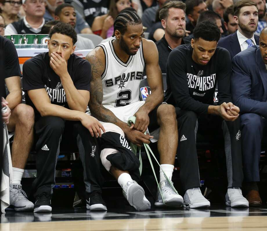 Spurs' Kawhi Leonard (02) stretches out his legs on the bench during the game against the Houston Rockets in Game 5 of the Western Conference semifinals at the AT&T Center on Tuesday, May 9, 2017. Spurs defeated the Rockets, 110-107. (Kin Man Hui/San Antonio Express-News) Photo: Kin Man Hui/San Antonio Express-News