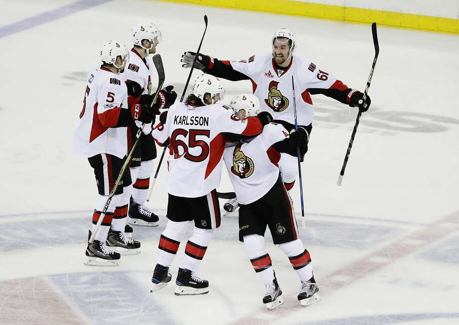 The Senators' Mark Stone (61) and Erik Karlsson celebrate with teammates during the third period of their clinching Game 6 victory over the New York Rangers at Madison Square Garden. Photo: Frank Franklin II, Associated Press