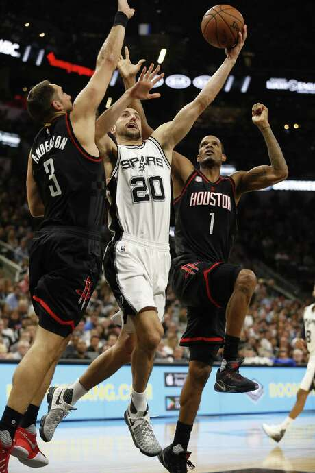 Spurs' Manu Ginobili (20) attempts a score against Houston Rockets' Ryan Anderson (03) and Trevor Ariza (01) in Game 5 of the Western Conference semifinals at the AT&T Center on Tuesday, May 9, 2017. (Kin Man Hui/San Antonio Express-News) Photo: Kin Man Hui, Staff / San Antonio Express-News / ©2017 San Antonio Express-News