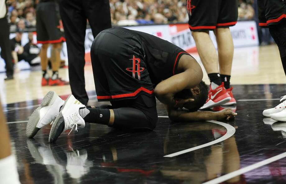 Houston Rockets' James Harden lies on the floor after getting fouled during Game 5 of the Western Conference semifinals against the Spurs at the AT&T Center on May 9, 2017. Photo: Kin Man Hui /San Antonio Express-News / ©2017 San Antonio Express-News
